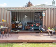 An old sea freight container becomes the ultimate family hangout compete with deck and Spacies machine