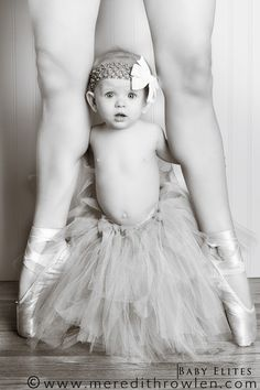 Yep. Have to do this. Could put Emma in her ballet outfit, sitting cross-legged by my feet. Or if we have another girl, do this exact picture. :)