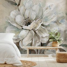 Floral design doesn't have to be overwhelming. In fact, floral murals in subtle colours can be beautifully styled in any room to create a stylish neutral statement. Start your bedroom decor with a minimal bed and white bedding. Style with light wooden decor in the form of a wooden bench and add rattan storage and woven rugs for a warm, Scandi style feel. Add house plants to continue the garden theme. Head to our Instagram for more inspiration!