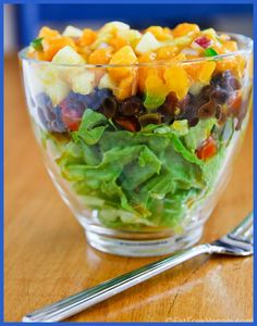 Summer is almost gone, Summer Salads aren't... Layered Salad, with Blasck Beans and Ma ngo Cucumber Salsa! http://blog.fatfreevegan.com/2012/07/layered-salad-with-black-beans-and-mango-cucumber-salsa.html #fatfreevegan #summersalads #salad #plantbased #glutenfree #vegan #plantstronghealthandfitnesswithmelanie