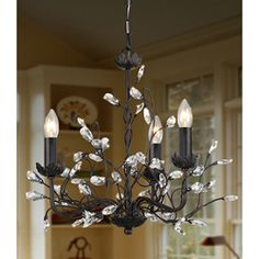 @Overstock.com - Iron and Crystal 3-light Chandelier - This elegant chandelier makes quite a statement. Use this fixture in spaces throughout the home. It is designed with a three-light display. With its ironwood display, this light accents furnishing styles. This modern fixture works with similar decor.  http://www.overstock.com/Home-Garden/Iron-and-Crystal-3-light-Chandelier/3285775/product.html?CID=214117 $168.29