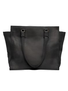 With clean lines and a classic look, our first top zip tote is spacious enough to contain all of your everyday essentials. Carry it with you to work to hold your laptop or an extra pair of shoes on a