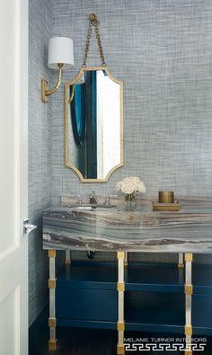 Patterned marble evokes sand and sea in the brass-accented powder room. Carrara, Beautiful Family, Beautiful Homes, Powder Room Design, Room Accessories, Beautiful Bathrooms, Bathroom Inspiration, Master Bathroom, Bathroom Sinks