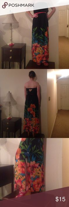 Tropical maxi dress! Maxi dress with bright tropical colors decorating the bottom. Slit down the left side. Comes with a thin braided pink belt. Lining underneath stops around the knees. The waist is elastic and so is the top! Only worn once! Maurices Dresses Maxi