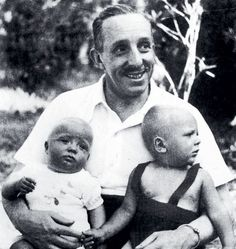 Proud grandfather.  King Alfonso XIII of Spain holding grandsons Infante Juan Carlos, future King of Spain, left, and Marco Torlonia, son of his daughter Infanta Beatriz.