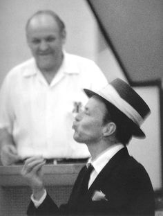 Frank Sinatra in the studio recording Swing Along with me with arranger Billy May, 1961