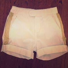 White shorts with gold stripe Jcrew white cotton shorts with gold stripe down the side. Elastic band at waist. J. Crew Shorts