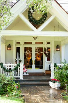 I love this front door....so welcoming.  And the wreath in the diamond shape of the front porch