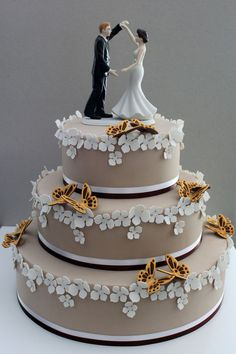 Wedding Cake with flower paste butterflies.  I like the butterfly detail and imagine them in royal blue.  It would be really breathtaking.
