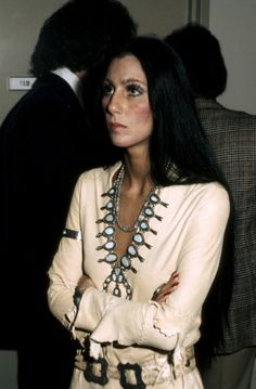 1970s - More Native Cher, embraced her Cherokee heritage and wore many Native American styles including this leather tunic and turquoise necklace. Goodness. A Cherokee embracing Dine jewelry for the fashion sense, not because she's truly proud of her Generokee heritage. No offense to real skins who truly are tribally affiliated Cherokee.