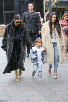 Kourtney and Kim Kardashian visit an ice-cream store with Penelope #dailymail