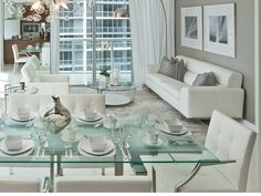 I love glass tables. They make a room sparkle and gives a greater feeling of space. This glass dining room table seems to support the feeling of light in this white monochromatic room designed and furnished by Tui Lifestyle. http://www.tuilifestyle.com/
