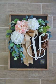 *** Buy 2 items from WreathDreams and get 10% off your order. Discount shown at checkout. A beautiful & refreshing Year-Round wreath decorated with white & pale pink Hydrangea blooms & a generous spread of mixed Eucalyptus complemented by a large tan burlap bow. ❤ Wreath shown is a