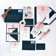I don't care much for the nautical images, but the rest of the invites I love! Stripes, navy, & blush. Maybe replace the anchor with a fleur de lis!