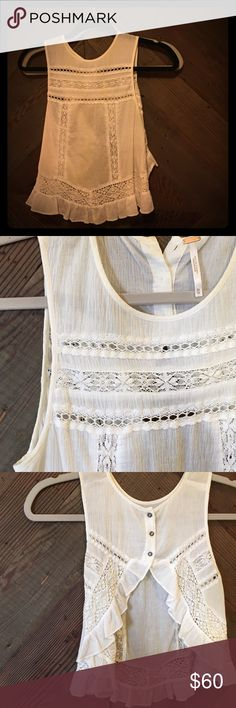Free People Crochet Lace open Back White Blouse White high low Free People lace and crochet adorned ruffled blouse. On the back it fastens at the neckline creating an open back with ruffled edges. Perfect with a statement bralette and high waisted shorts or skirt! Free People Tops Blouses