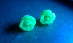 Glow in the dark rose earrings I made. They can come just as studs or as the front of a pair of fake gauges as you will see in another picture I have posted. Check out my facebook to place custom orders: www.facebook.com/brookes.customs