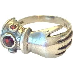 Victorian sterling silver and garnet figural hand ring