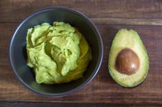 Combine mashed avocado and olive oil for a restorative hair treatment - Westend61/ Westend61/ Getty Images