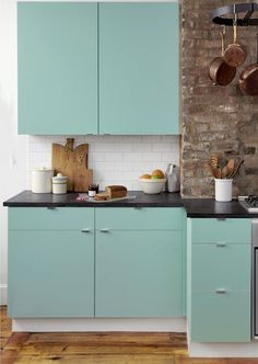 Five Ways to Customize Kitchen Cabinets with Colored Contact Paper #apartmenttherapy #DIY #kitchen