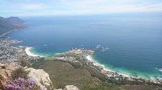 Clifton and Camps Bay, a view from the peak of Lions Head. Blue sea, white sandy beaches.