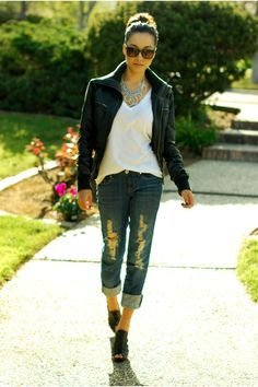 Black Leather jacket, v neck white tee, distressed jeans and heels. Yes!