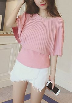Front view of model in pink ribbed knit cape top