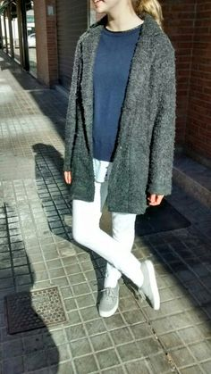 Grey Pull&Bear coat, blue Mango sweater, white Zara pants and grey Vans slippers