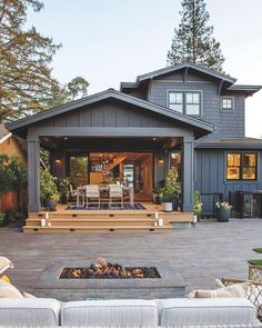 This home has a gorgeous outdoor patio area! Perfect for summer BBQs! Would yo… This home has a gorgeous outdoor patio area! 😍 Perfect for summer BBQs! 🏡 Would you want to live in a house like this? TAG a friend who will love this! Future House, Back Porch Designs, Haus Am See, Design Exterior, Exterior Colors, House Exterior Design, Simple House Exterior, Cafe Exterior, Gray Exterior