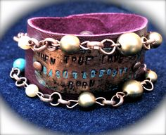 """Copper stamped with children's birth dates and a message of """"When True Love Was Born."""" Riveted onto a leather cuff and adorned with pearls and turquoise beads and copper links. One of a kind!"""