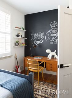 A blackboard wall in the bedroom lets designer Ines Mazzotta's 9-year-old son, Jake, pay tribute to his favorite bands and superheroes. | Photographer: Robin Stubbert