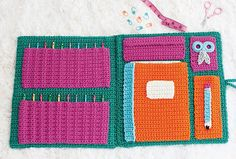 Store your hooks, scissors, stitch markers, and other tools inside this handy crochet portfolio. One side of the folder has pockets for up to ten crochet hooks, and the other has a place to store your favorite journal for jotting down pattern notes. Slide two pieces of chipboard in between the front and back sections to make the case sturdy as well as stylish.