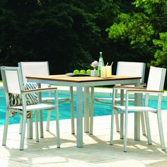 Sling dries quickly and is ideal for use around the pool - Oxford Garden Travira 4-Person Sling Patio Dining Set With Stacking Chairs