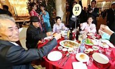 South Korean Park Un-hyung (left) raises a toast with his daughter and brother living in North Korea during a reunion at the North's Mount Kumgang resort. Photograph: Yna/EPA