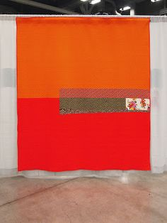 Bright & beautiful Denyse Schmidt quilt.