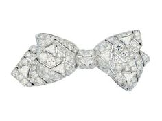 An Art Deco Diamond and Platinum Brooch, circa 1930 The ribbon bow of pierced design and decorated with trilliant-cut diamonds amid a ground of pavé-set round diamonds, mounted in platinum Diamond Bows, Diamond Brooch, Art Deco Diamond, Victorian Jewelry, Vintage Jewelry, Titanic Jewelry, Art Nouveau Jewelry, Tiffany Jewelry, High Jewelry