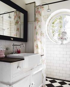 Inspiration for a bathroom remodel Love the round window, white subway tiles and the diamond black and white flooring. With the black rectangular mirror frame this small bathroom has quite a dynamic, active energy (with a feminine touch of the flower shower curtain) and is excellent for any Water or Metal feng shui area of your home (North, West and Northwest) Lovely!