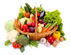 Vegetables Carrots Tomatoes Cabbage Pepper Cucumbers Onion Garlic Wicker basket White background Food