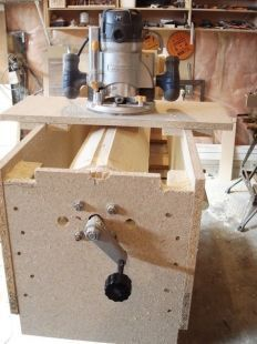 Router Lathe - Homemade router lathe consisting of a wooden box frame with MDF end caps. Intended to facilitate the process of utilizing a router to create round columns.