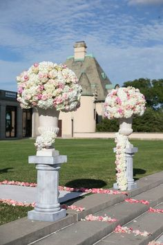 Ceremony Entrance with Flower Arrangements in Urns on Stone Pedestals | Photography: Brett Matthews Photography. Read More:  http://www.insideweddings.com/weddings/regal-outdoor-ceremony-ballroom-reception-at-oheka-castle-in-ny/821/