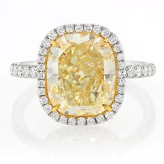 we are OBSESSED with our new 4.53 Carat Fancy Light Yellow Diamond Ring in Platinum/18K Gold!! WOW!!
