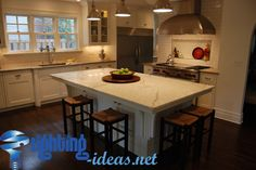Kitchen with dining table and pendant lamps