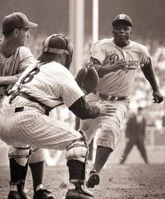 Jackie Robinson stealing HOME! Check out the batter; he doesn't seem to notice that Jackie is about to slide right under him!