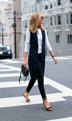 This navy double-breasted vest and olive fringe sandals paired with ripped skinny jeans and a simple white tee is the perfect Casual Friday look. Sleeveless Blazer Outfit, Black Vest Outfit, Vest Outfits, Casual Outfits, Long Vest Sleeveless, Black Sandals Outfit, Formal Outfits, Nyc Fashion, Work Fashion