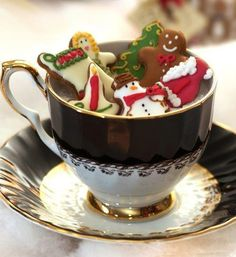 Christmas idea! use a vintage cup to display cookies.