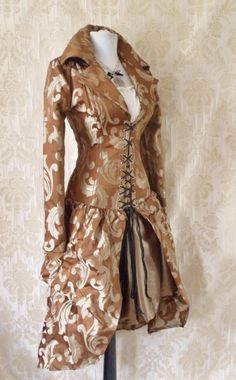 AliceandWillow @ Etsy...Valkyrie bustle corset coat Steampunk/ Victorian inspired bustle corset coat, made from caramel swirl tapestry fabric on the outside and coutil cotton inside. This coat comes to below knee length and has a gently curved hemline. The coat is steel boned and laces up the front and is plain at the back. The coat is long sleeved and has a double lapel collar. (NLA)  #provestra
