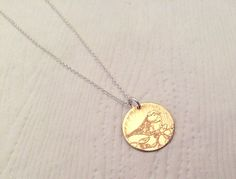 Etched Brass and Sterling Silver necklace with bird on branch design.  www.facebook.com/AmbersWhimsy