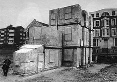Rachel Whiteread, House, 1993. She works with negative space. This is a concrete cast of the interior of a Victorian home.
