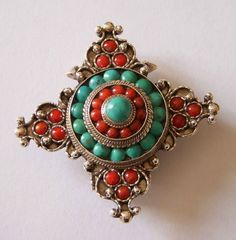 A Gao is often used in Tibet, Nepal, Bhutan as an amulet. It provides protection from illness and bad luck. Usually inside is placed a scroll upon which is written a prayer or a mantra. This beautiful Gao Pendant is in 925%  sterling silver and is embellished with Coral and Turquoise #pendant #gao #turquoise #coral #goodluck