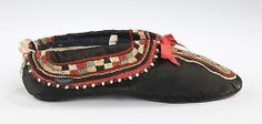 #British silk slippers ca. 1825. As the countries of Europe spread their empires across the globe, accounts of the mysterious and exotic peoples of foreign lands captivated the audience at home. These British slippers are an unusual close imitation of Native American footwear. Despite their faithful resemblance to actual moccasins of the Great Lakes region, the shoes are made entirely with Western construction techniques.