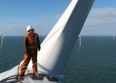 Engineer atop Offshore Wind Turbine (Courtesy 3Sun).